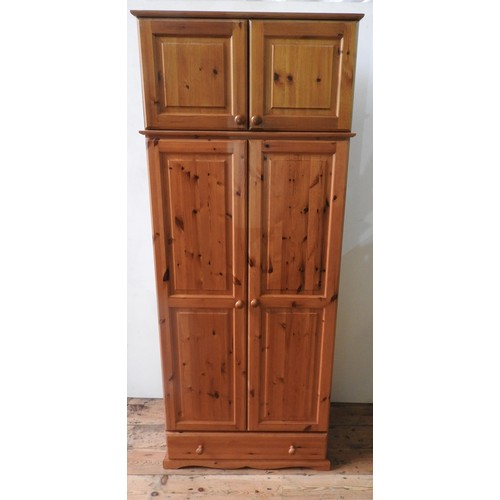 55 - A PINE PANELLED WARDROBE, A PINE WARDROBE WITH TOP LOCKER A ND A PINE CHEST OF SIX DRAWERS, and a pa...