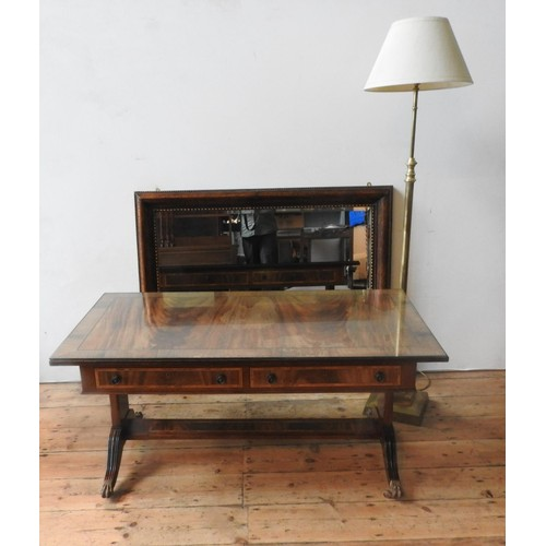 56 - A 20TH CENTURY MAHOHGANY STYLE COFFEE TABLE, STANDARD LAMP AND MIRROR, the regency-style coffe table...