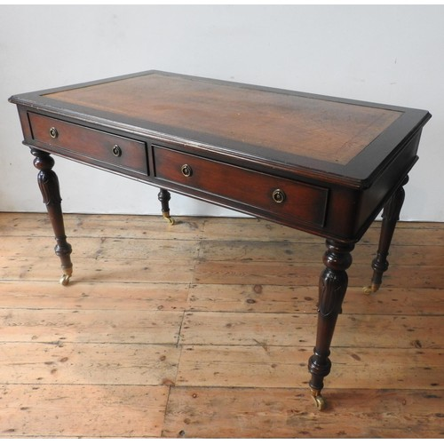 57 - A 20TH CENTURY MAHOGANY REGENCY STYLE LIBRARY TABLE, with leather top, the legs carved with tulip de...
