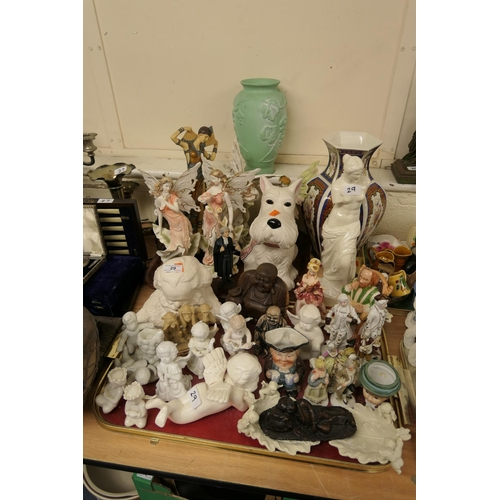 29 - Decorative china figures including character jug, cherubic figures, also fairies etc (2 trays)...