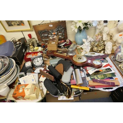 35 - Miscellany including barometer, alarm clocks, sunglasses, leather bookmarks, vintage recorder, badge...