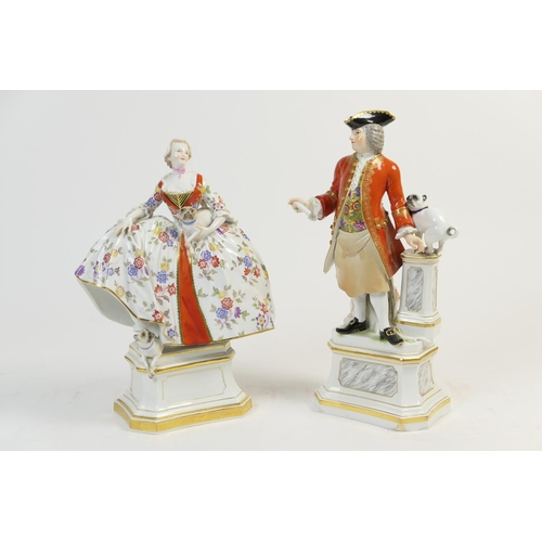 24 - Meissen porcelain figure of a lady with pug dogs, in 18th Century style, decorated in colours and wi...