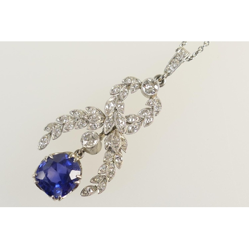 244 - Edwardian sapphire and diamond pendant necklace, the old cushion cut sapphire of approx. 1ct of good...
