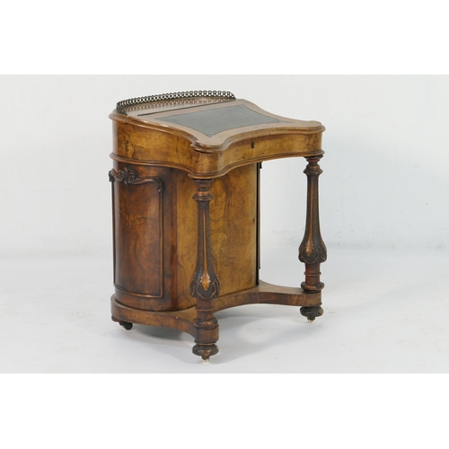 588 - Unusual Victorian walnut davenport, by J Kerr & Co.,  circa 1845-55, having a rounded back with bras...