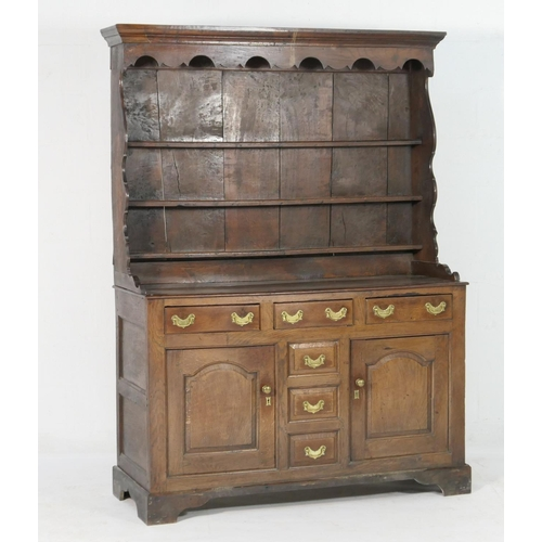 590 - George II oak dresser, North Wales, circa 1740, boarded rack with moulded cornice and shaped apron, ...