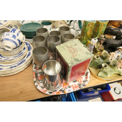 32 - Pewter tankards and goblets...