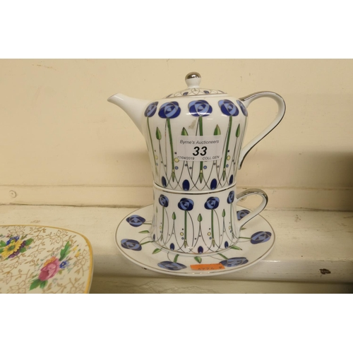 33 - Leonardo tea-for-one service, decorated in the Mackintosh style...