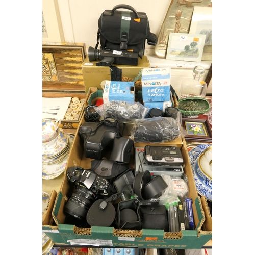 41 - Canon AE-1 camera, further Canon AE-1 camera, assorted lenses and accessories and further cameras...