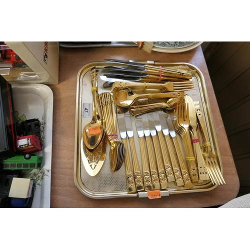 47 - Loose suite of gold plated community cutlery...