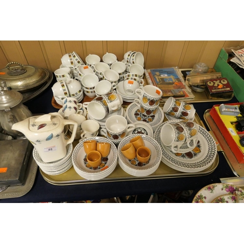 55 - Meakin Frolic patterned coffee service and other retro pottery tea and breakfast wares (2 trays)...
