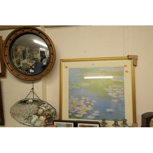 23 - Gilt framed convex wall mirror; also after Claude Monet, 'Water Lilies' gilt framed print (2)...