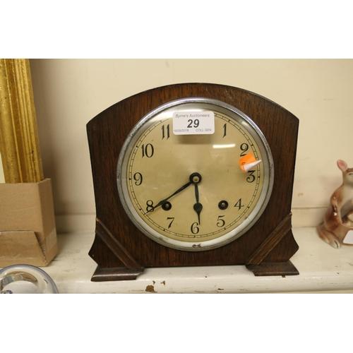 29 - Oak cased chiming mantel clock...