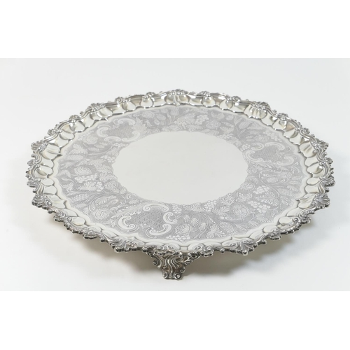 151 - George IV silver salver, by William Eley II, London 1828, having a raised shaped border detailed wit...