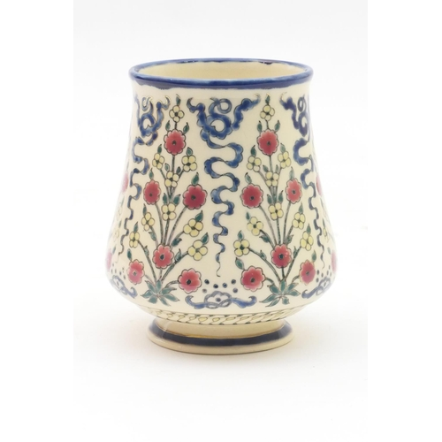 24 - Zsolnay Pecs small vase, baluster form with a wide neck and decorated with a Persian inspired formal...