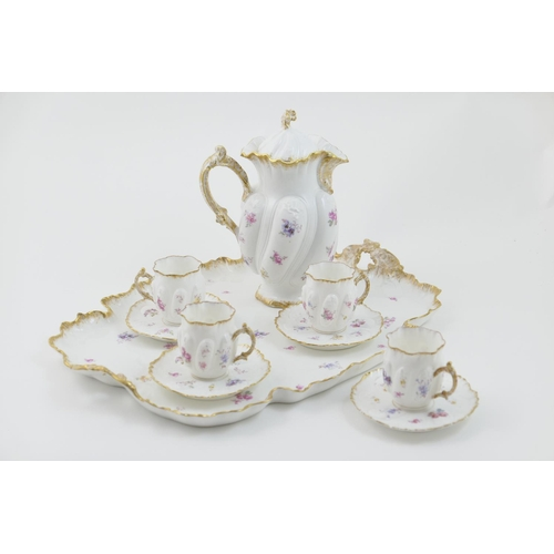 28 - French porcelain cabaret set, circa 1900, comprising shaped tray with moulded gilt edge and decorate...