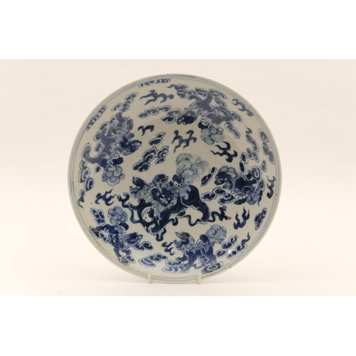 40 - Chinese blue and white plate, late 19th Century, decorated with mythical dogs amidst clouds, and wit...