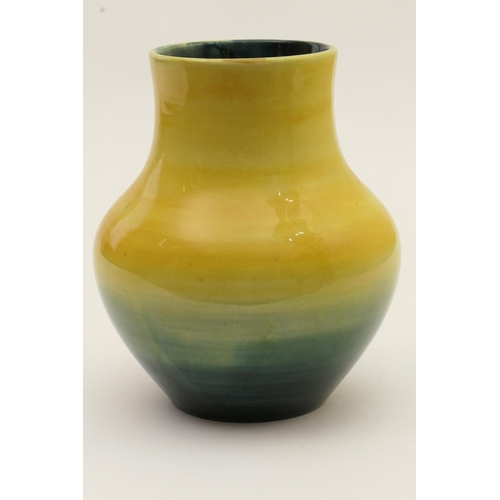 45 - Moorcroft baluster vase, circa 1930s/40s, decorated with a shaded yellow through to blue ground, imp...