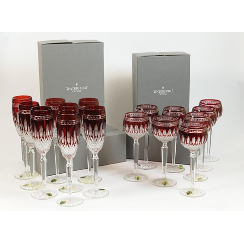 48 - Waterford Clarendon ruby glassware comprising eight champagne flutes and eight hock glasses, unused ...