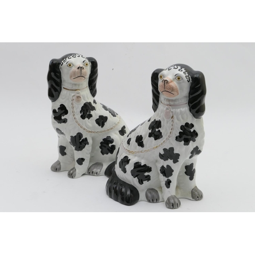 50 - Pair of Victorian Staffordshire spaniels, circa 1870, finished in black and white glazes, height 26....