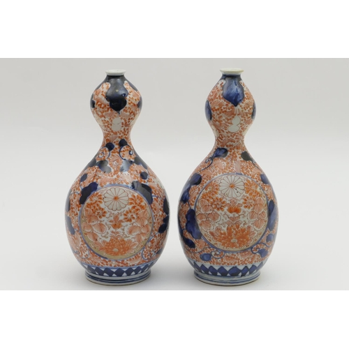59 - Pair of Japanese Imari gourd vases, late 19th Century, decorated in typical palette with peony and c...