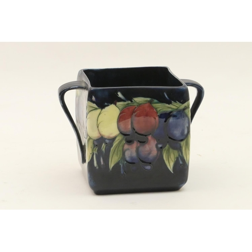 7 - Moorcroft Wisteria biscuit box, circa 1918-29 twin handled square section (lacking cover), with a de...