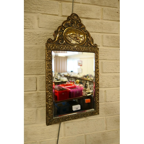 11 - Late Victorian embossed brass framed mirror...
