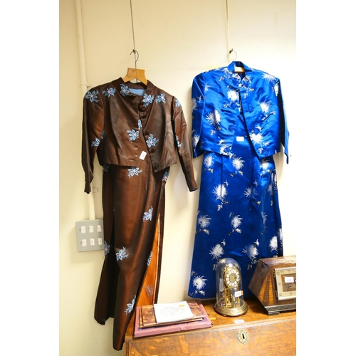 136 - Two Oriental silk embroidered dresses complete with jackets and boxed silk scarves...