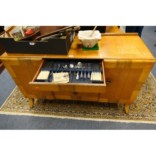 597 - Beautility oak sideboard complete with cutlery...