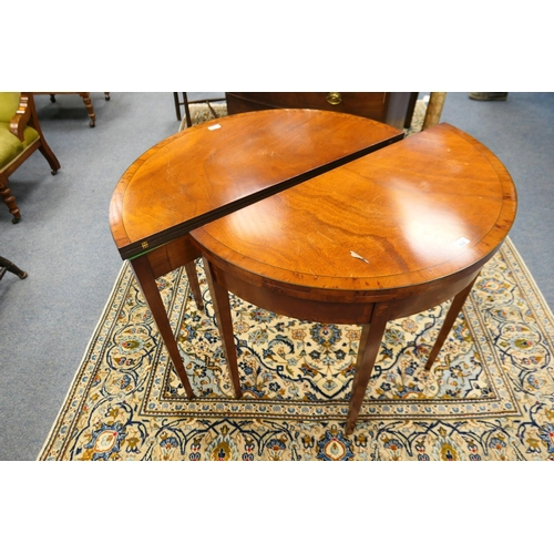 636 - Pair of reproduction walnut and yewood demi-lune folding tea tables...