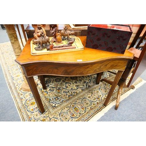 640 - George III mahogany serpentine side table...