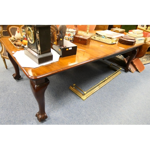 641 - Late Victorian or Edwardian mahogany extending dining table, circa 1900, the top with moulded edge w...