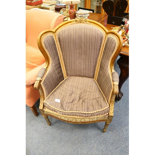 642 - French carved walnut and parcel gilt upholstered tub chair...