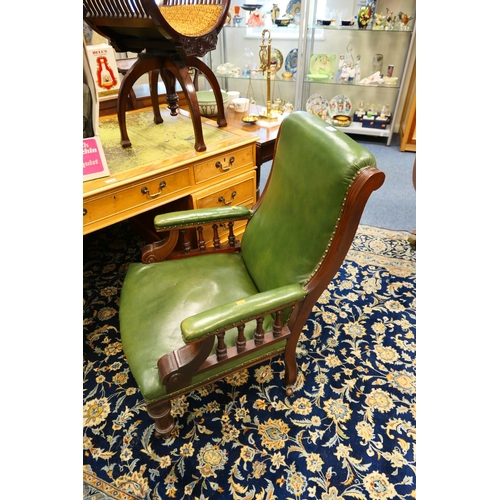 648 - Victorian mahogany framed green leather upholstered armchair...