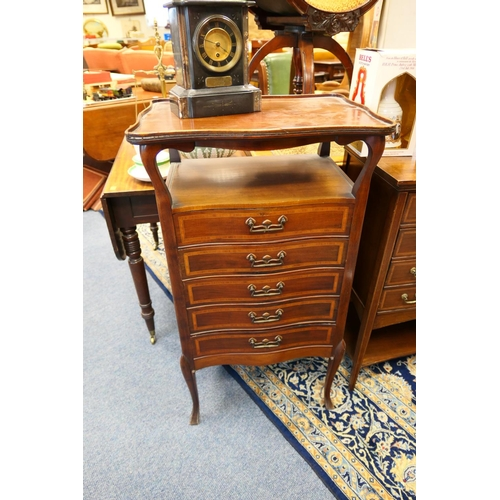 653 - Edwardian mahogany and inlaid music cabinet in the Art Nouveau style...
