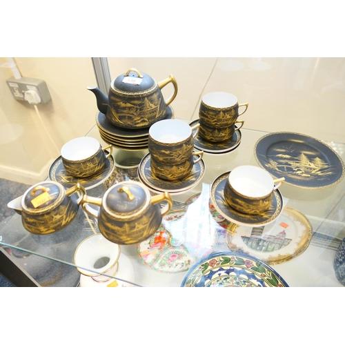 138 - Japanese Kobe china gilded matte black porcelain tea service...