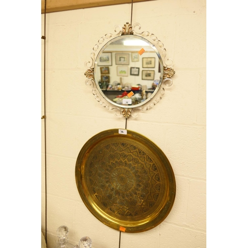 36 - Attractive bevelled glass circular wall mirror and a Cairo ware brass tray (2)...