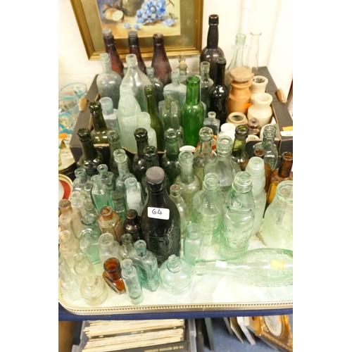 64 - Collection of vintage drinking bottles including codd bottles...