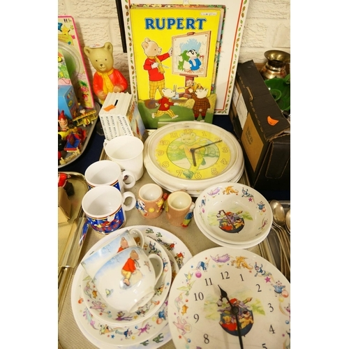 8 - Rupert the Bear china collectables, vintage Rupert the Bear clock, figure, annuals etc (1 tray)...