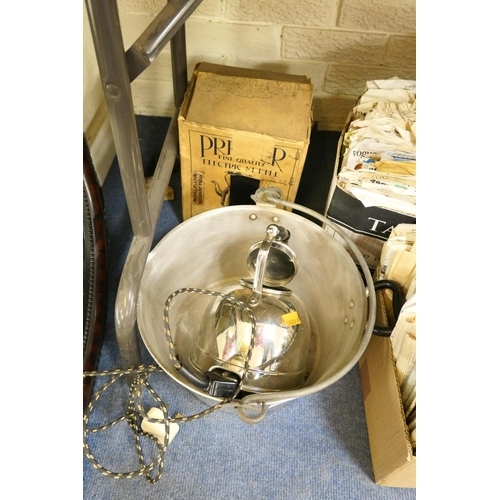 66 - Bevelled glass oval wall mirror, aluminium preserve pan and a kettle...