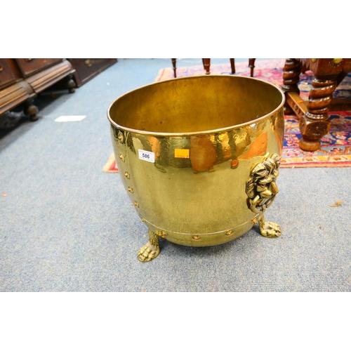 586 - Brass log bin with lion mask handles...