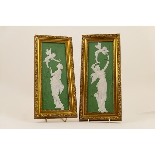 11 - Pair of Continental green jasperware plaques, each featuring a winged Cupid adorning a maiden with f...