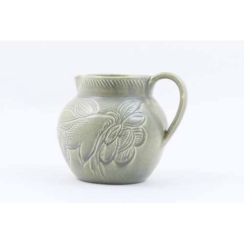 16 - Susie Cooper celadon milk jug, with incised foliate decoration, incised signature mark, height 13cm...
