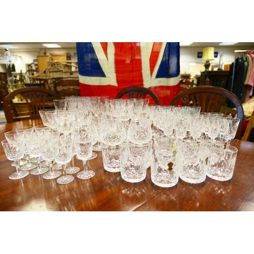 18 - Suite of Waterford Lismore cut crystal glassware, comprising eleven champagne flutes, six red wines,...