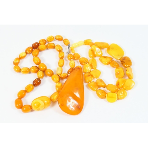210 - Butterscotch amber jewellery comprising oval beaded necklace, the largest central bead measuring app...