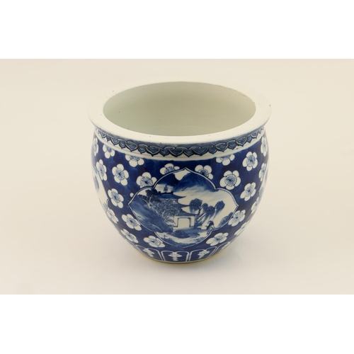 26 - Chinese blue and white jardiniere, late 19th Century, decorated with landscape panels against a prun...