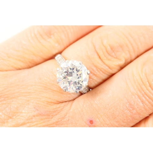 282 - Good diamond ring, set with a certificated central round brilliant cut stone estimated at 4.45cts, c...