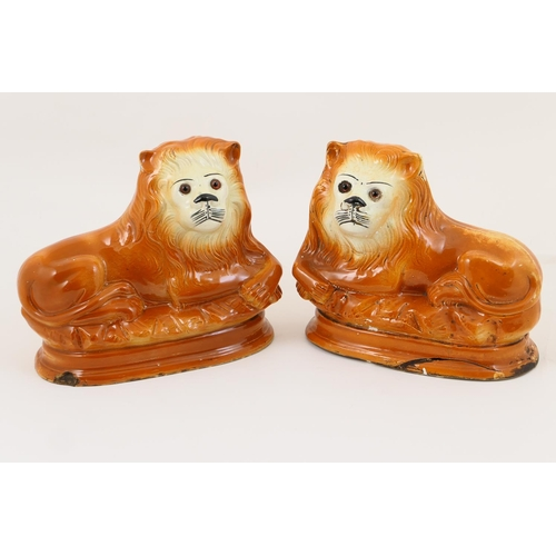 29 - Pair of Staffordshire pottery lions, probably James Kent, circa 1900-10, decorated in a terracotta g...