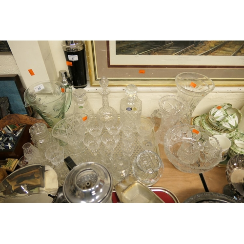 38 - Mixed cut crystal glassware including decanters, bowl and vases...
