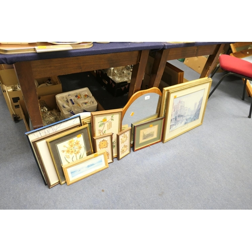 138 - Assorted pictures and prints and a wooden framed mirror...