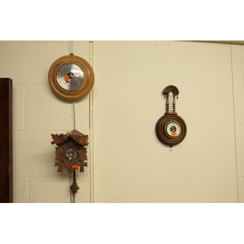 34 - Victorian carved walnut aneroid barometer, modern aneroid barometer and a cuckoo clock (3)...